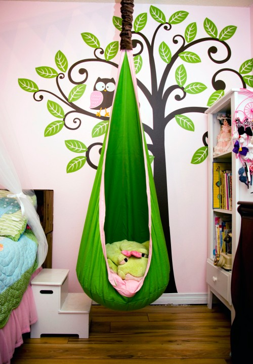 Idyllic tree-swing reading nook, created by Tracy Rauch in her daughter's room. (http://pinterest.com/tracyrauch/) A similar example is on JenWCom's flickr at http://www.flickr.com/photos/jenwcom/4914477695/in/pool-539895@N24/.  Both moms have been gracious in answering questions in how they accomplished the look.