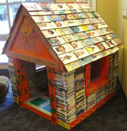 "This charming book house is in the Iowa Public Library (featured in Flavorwire's ""10 Gorgeous Buildings Made Out of Books"" by Emily Temple, Apr. 2012), but could be created in a children's room."
